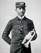 """BRIDGEMAN ART LIBRARY  W. C. Handy, """"Father of the Blues"""" and a son of former slaves, recorded a 1903 encounter with a man playing an instrument that was evolving from an African zither into an American slide guitar."""
