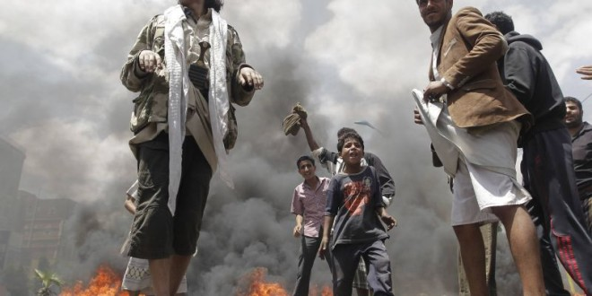 Protesters burn tyres during a demonstration against against Yemen's fuel shortages near the house of President Abdu Rabbu Mansour Hadi in Sanaa