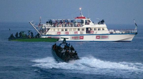 Israeli forces approach one of six ships bound for Gaza in the Mediterranean Sea