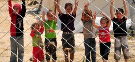 Syrian refugee children flash V-signs at