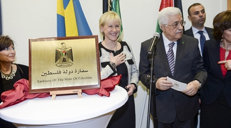 Palestinian President Mahmoud Abbas (C, right) speaks next to Swedish Foreign Minister Margot Wallstrom (C) during the inauguration of the Embassy of Palestine in central Stockholm February 10, 2015.