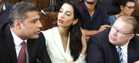 Canadian Al-Jazeera English journalist Mohammed Fahmy, left, his lawyer Amal Clooney, centre, Canadian ambassador to Egypt, Troy Lulashnyk