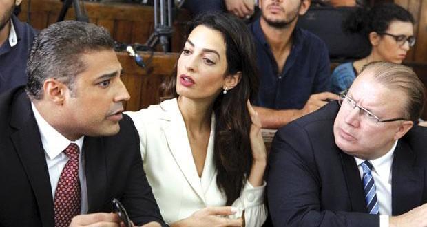 Canadian Al-Jazeera English journalist Mohammed Fahmy, left, his lawyer Amal Clooney, centre, Canadian ambassador to Egypt, Troy Lulashnyk